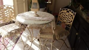 Wrought iron table set with matching plant stands indoor outdoor