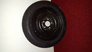 Chrysler small spare tire .Brand New.Donut Tire