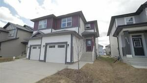 PRICE DROP! Beautifully Finished Half Duplex w Garage!