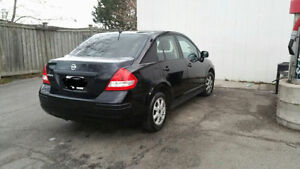 2010 Nissan Versa Sedan. Excellent gas 1.6L . power window lock