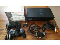 Sony Playstation 2 + 2 Controllers + 9 games.