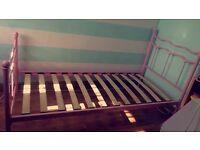 pink single metal bed frame.
