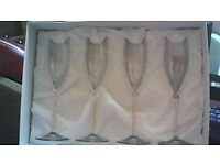 Set of four champagne/wine glasses