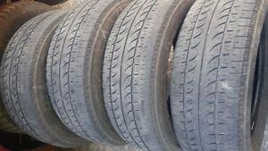 4 pneus 4 saisons de 15 pouces et 4 rims et pneus de 14 pouces