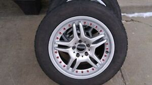 225/60 R17 Goodyear Winter tires, on Mercedes ML500 rims