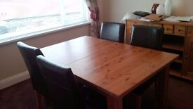Ikea stonas dining table with 6 faux leather chairs and matching sideboard