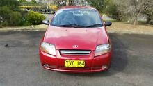 2003 Daewoo Kalos T200 Limited Burgundy 5 Speed Manual Hatchback Ingleburn Campbelltown Area Preview