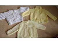 3 knitted baby cardigans