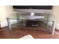 Glass TV stand with 2 shelves.