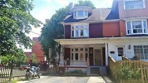 This Spacious 5 Bedroom, 2 1/2 Storey Turn-Of-The-Century Home