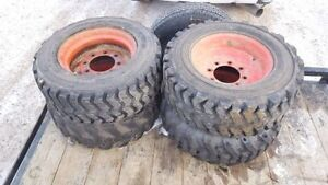 BOBCAT RIMS AND TIRES - (SET OF 4)