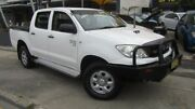 2011 Toyota Hilux KUN26R MY11 Upgrade SR (4x4) White 5 Speed Manual Dual Cab Chassis Homebush Strathfield Area Preview