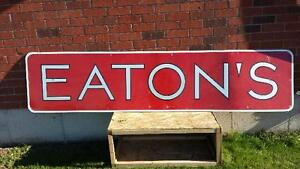Old Eaton's sign and porcelain 7 Up sign