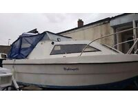 Weston 560 fishing cabin boat with 60 hp yamaha outboard and trailer