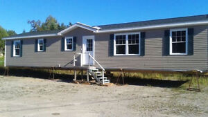 Buy this New 2 Bdrm. Mini-home now and no payments until Mar 17