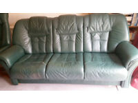 3 piece suite in green leather comprising 3 seater settee and 2 swivel/reclining armchairs