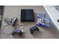 PS4 console, 2 pads, camera and 5 games
