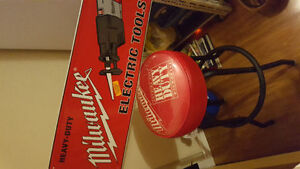 Milwaukee Tools tin sign and bar stool
