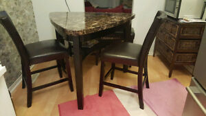 Pub style dining table with chair.