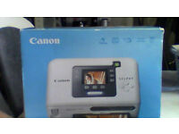 CANON selphie compact photo printer in excellent condition still in box with photo cards