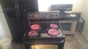 Black GE Range and Microwave. 200 $ OBO. W/Delivery.