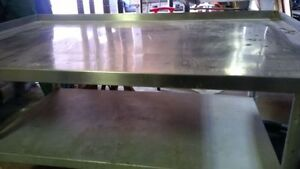 "30""x48"" stainless steel equipment stand in good condition"