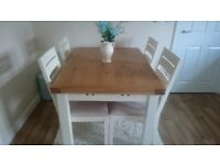 solid oak/cream provence extending dining table and 4 upholstered chairs