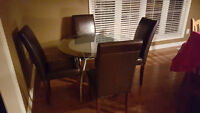 Round glass table with 3 parson chairs