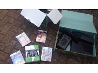 X box 360 US version with AC adaptor plus 4 sealed games