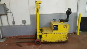 Forklift with battery and charger