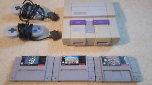 SNES with 2 controllers and 3 Classic games