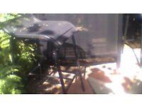 garden bar black two matching stools v. good condition. black glasstop.shelves and wine rack inside