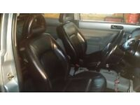 2002 VW Beetle black leather interior - front & rear seats