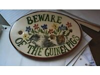 Beware of the Guinea Pigs sign