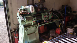 2 piece machinist lathe with several milk crates full of tooling