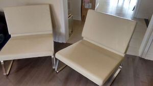 2 Contemporary Cream leather chairs