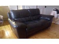 Black 2 seater leather sofa in good condition. Silver feet. L163cm xW95cmxH64cm.