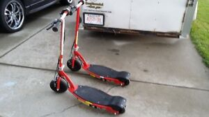 2 Razor E100 electric scooters with 1 charger