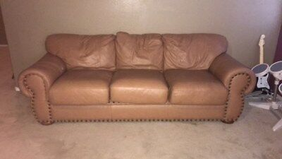 Light brown leather couch.Used, but in good condition overall. $200 ()