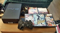 Price Reduced: PS2 with 5 games, 2 DDR mats, Controller, etc.