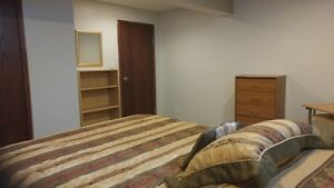 Basement room for rent at Evergreen SW Calgary