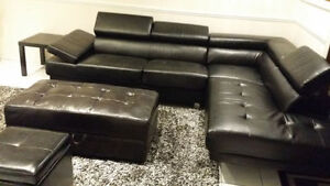 Black leather sectional sofa with 2 ottomans
