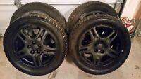 Four beautiful 205/55r16 Subaru rims and winter tires