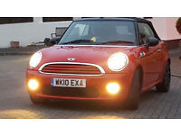 "2010 Mini Convertible with ""Full Cooper Works kit""Showroom Condition ""VERY LOW Mileage"" 10,886miles."