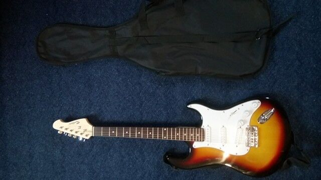 Rockburn electric guitar barely used with shoulder strap and case