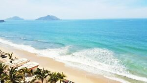 Luxurious beachfront condo in a resort-style community – NEW!