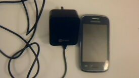 SAMSUNG GALAXY young touch phone with charger needs a new battery