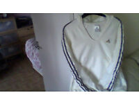 ADIDAS cream sweater size 12 has a hoodand pockets with stripes down arms