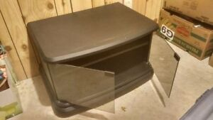 Black swivel TV stand on wheels with shelf and glass doors