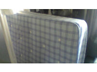 blue double mattress with medium spring to it in good condition